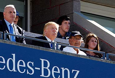 American business entrepreneur Donald Trump watches the US Open first round match between Maria Sharapova and Heather Watson
