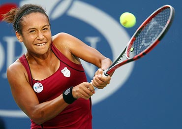 Heather Watson plays a return against against Maria Sharapova