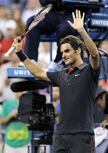 Roger Federer celebrates after defeating Santiago Giraldo