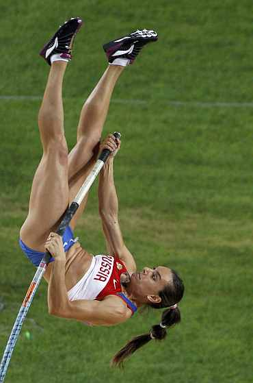 Yelena Isinbayeva competes in the women's pole vault final at the IAAF World Championships in Daegu