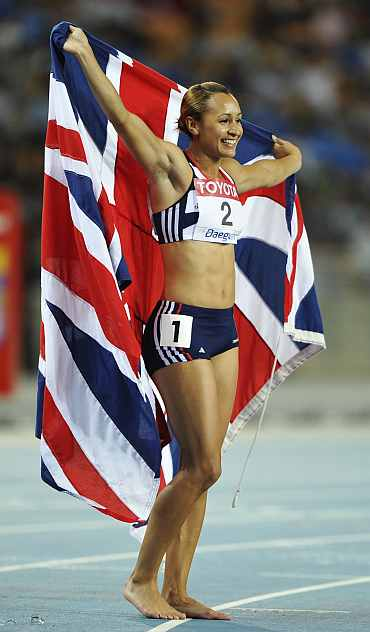 Jessica Ennis of Britain celebrates after the 800 metres event of the women's heptathlon