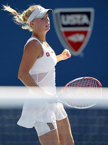 Caroline Wozniacki celebrates after beating Nuria Llagostera Vives
