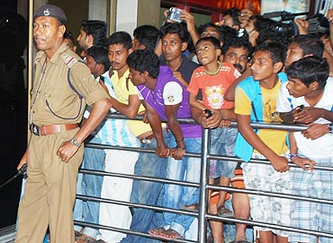 Messi's fans wait to catch a glimpse of the star at the Kolkata airport