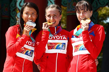 Silver medalist Hong Liu of China, gold medalist Olga Kaniskina of Russia and bronze medalist Anisya Kirdyapkina of Russia on the podium