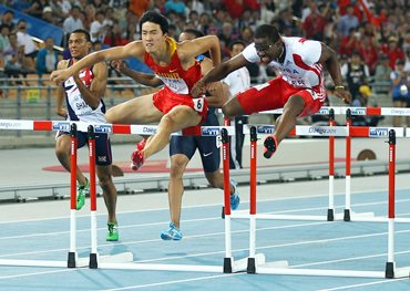 Dayron Robles of Cuba and Xiang Liu (left) of China during the men's 110 metres hurdles final on Monday