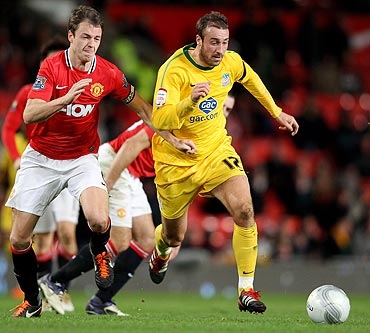 Glenn Murray of Crystal Palace competes with Jonny Evans of Manchester United