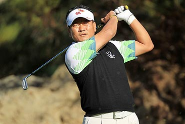 K.J. Choi of South Korea watches his tee shot