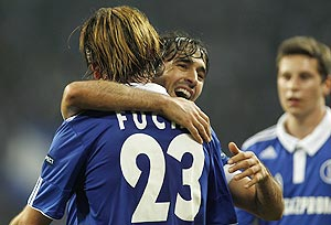 Schalke 04's Christian Fuchs and Raul (right) celebrate against Steaua Bucharest
