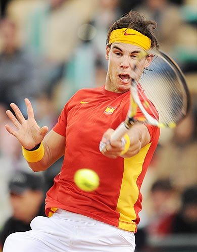 Rafael Nadal of Spain plays a backhand to Juan Monaco of Argentina