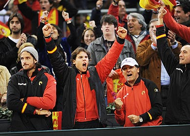 Rafael Nadal (centre) of Spain celebrates a point made by his team-mate David Ferrer
