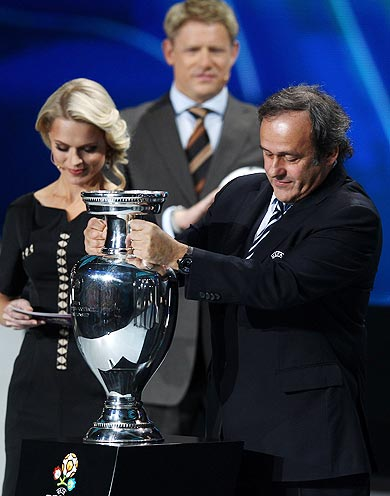Michel Platini, UEFA President places the trophy down during the UEFA EURO 2012 Final Draw Ceremony