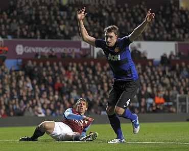Phil Jones celebrates after scoring against Aston Villa