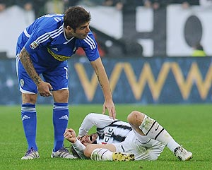 Alessandro Del Piero of Juventus FC lies injured on the pitch as Adrian Mutu checks on him during their Serie A match on Sunday