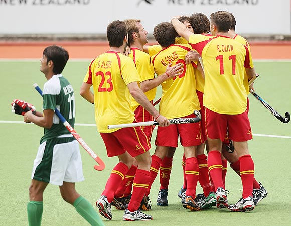 Spanish players celebrate after scoring against Pakistan during their Champions Trophy match in Auckland on Monday
