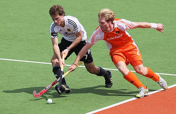 Oskar Deecke of Germany (left) and Klaas Vermeulen of Netherlands vie for possession during their Champions Trophy match in Auckland on Monday