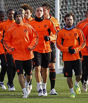 Chelsea players warm up before a training session in London on Monday