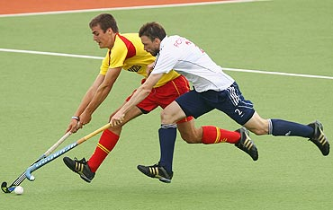Great Britain's Ken Forbes and Spain's Alex Casasayas vie for possession during their match on Tuesday