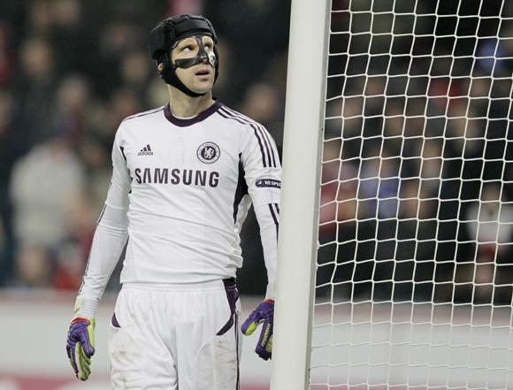 Chelsea goalkeeper Petr Cech reacts following his team's defeat against Bayer Leverkusen in the Champions League Group E  match in Leverkusen