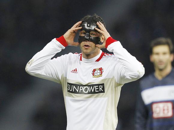 Bayer Leverkusen's Michael Ballack (L) reacts during the German Bundesliga soccer match against Hertha Berlin in Berlin