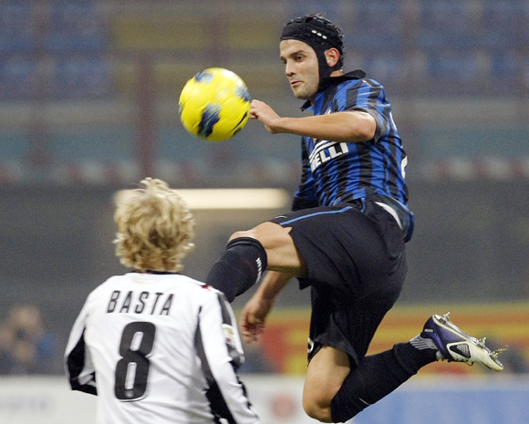 Inter Milan's Cristian Chivu (R) fights for the ball with Udinese's Dusan Basta in the Italian Serie A match at the San Siro in Milan