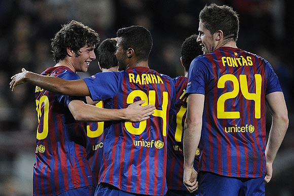 Sergio Roberto of FC Barcelona (left) celebrates with teammates after scoring against BATE on Tuesday
