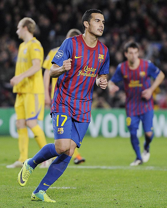 Barcelona's Pedro Rodriguez celebrates after scoring
