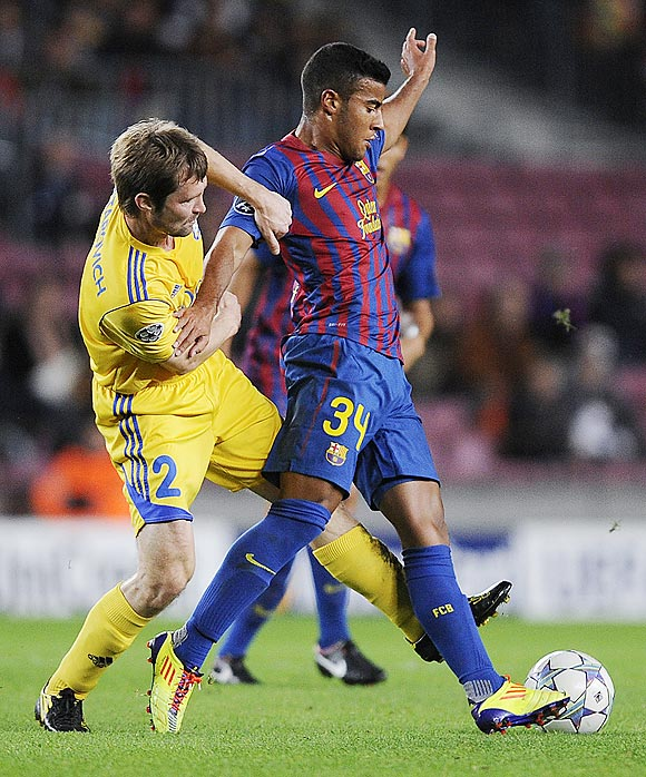 Barcelona's Rafinha (right) is challenged by Dmitri likhtarovich of FC BATE Borisov
