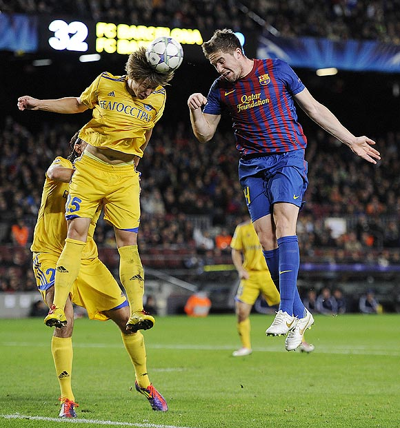 Barcelona's Andreu Fontas (right) is involved in an aeriel duel with Dmitri Baga of FC BATE Borisov