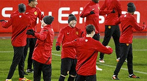 Manchester United's Wayne Rooney (centre) smiles during a team training session in Basel on Tuesday