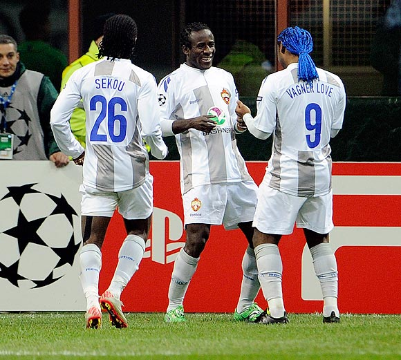 Seydou Doumbia (centre) of PFC CSKA Moskva celebrates scoring the first goal