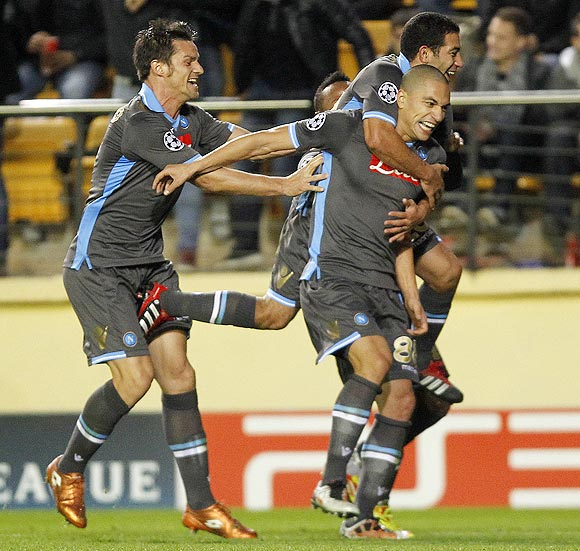 Napoli's Gokhan Inler (front right) celebrates with teammates Walter Gargano and Christian Maggio (left) after scoring against Villarreal