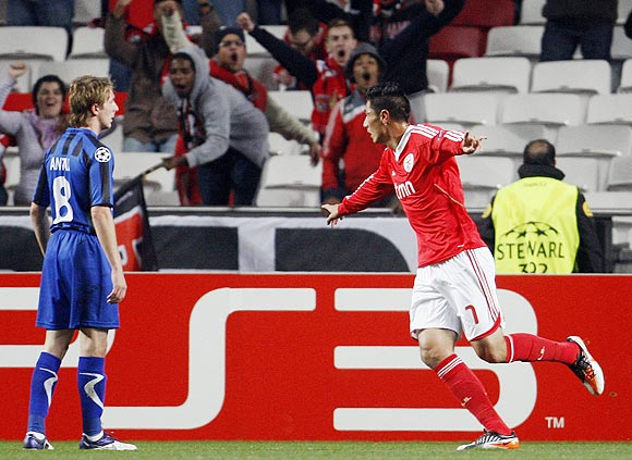 Benfica's Oscar Cardozo (right) celebrates beside Otelul Galati's Liviu Antal
