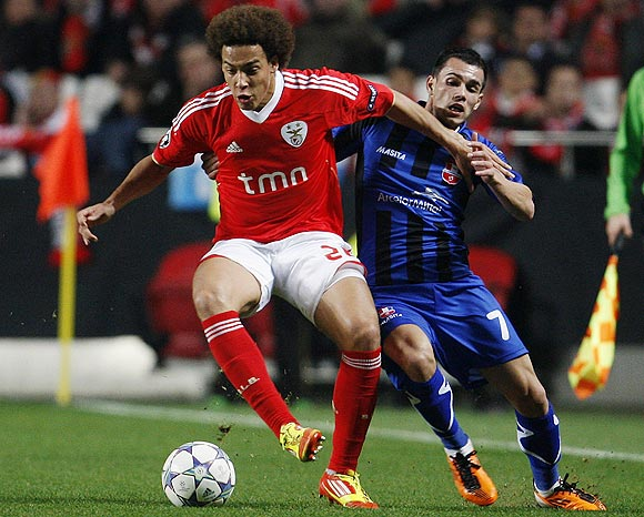 Benfica's Witsel Lambert (left) fights for the ball with Otelul Galati's Laurentiu Iorga