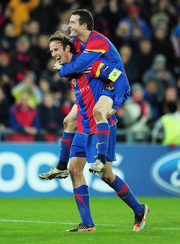 Fabian Frei and Marco Streller of Basel celebrate after beating Man U on Wednesday