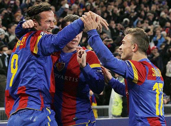 FC Basel's Marco Streller (left) celebrates with teammates Markus Steinhoefer (centre) and Xherdan Shaqiri after scoring