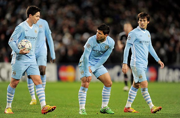 Samir Nasri (left) Sergio Aguero and David Silva (right)