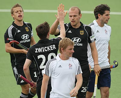 Thilo Stralkowski of Germany (right) celebrates with goal-scorer Martin Zwicker during their encounter against Great Britain