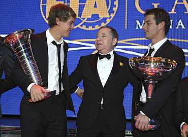 FIA President Jean Todt poses with Formula One World Champion Sebastien Vettel and Rally World Champion Sebastien Loeb during the 2010 FIA Prize Giving gala in Monaco