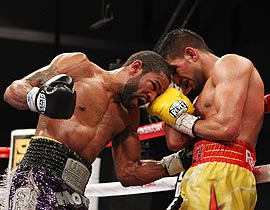 Lamont Peterson punches Amir Khan