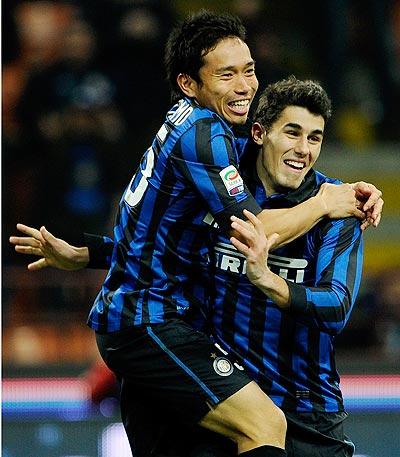 Yuto Nagatomo (left)  celebrates with Marco Davide Faraoni of FC Inter Milan