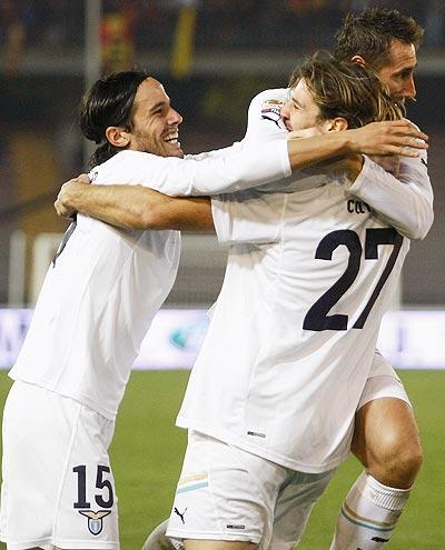 Lorik Cana (centre) of Lazio celebrates with team-mates Alvaro Gonzalez (left) and Miroslav Klose after scoring