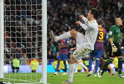 Cristiano Ronaldo of Real Madrid kicks the goalpost out of frustration as he fails to score