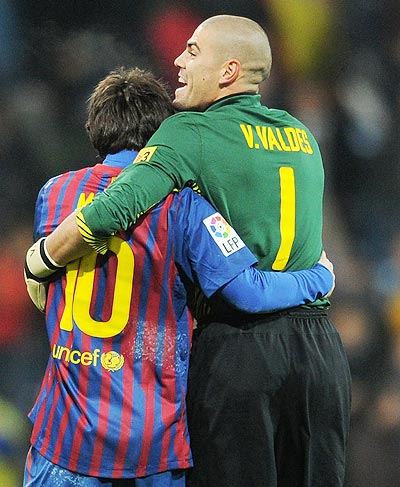 Goalkeeper Victor Valdes (right) of FC Barcelona celebrates with his team-mate Lionel Messi