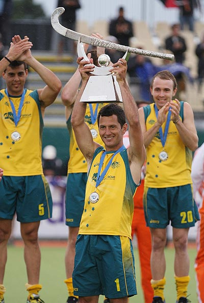 Jamie Dwyer of Australia holds up the trophy after winning the Champions Trophy