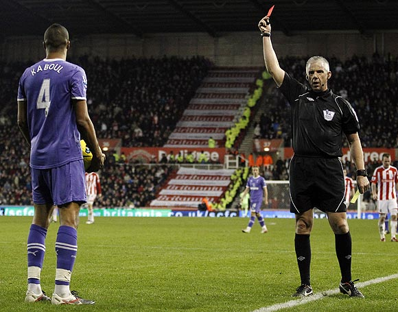 Tottenham Hotspur's Younes Kaboul (left) is sent off by referee Chris Foy