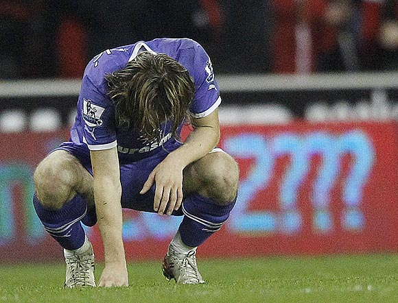 Tottenham Hotspur's Luka Modric is distraught after losing to Stoke City