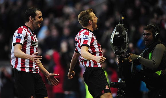 Sunderland goalscorer Sebastian Larsson (right) and John O'Shea celebrate the winning goal against Blackburn Rovers