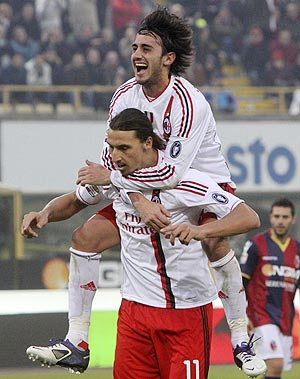 AC Milan's Zlatan Ibrahimovic celebrates with teammate Alberto Aquilani (top) after scoring a penalty against Bologna during their Serie A match on Sunday