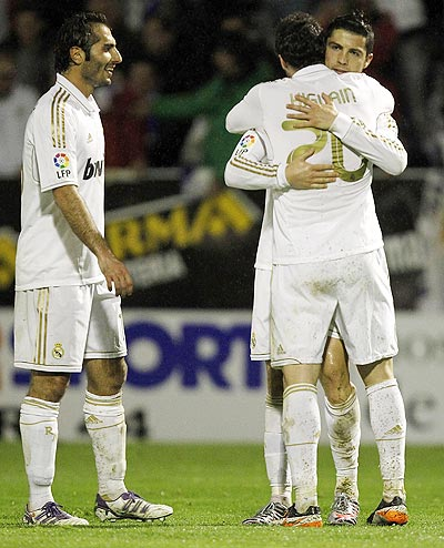 Cristiano Ronaldo (right) of Real Madrid celebrates after scoring with Gonzalo Higuain and Hamit Altintop (left)