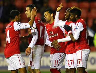 Arsenal players celebrate after scoing a goal